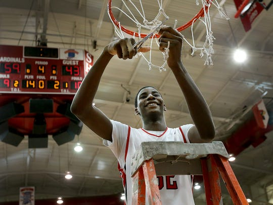Park Tudor's Jaren Jackson cuts down the nets following the IHSAA Boys 2A semistate basketball game, March 21, 2015.