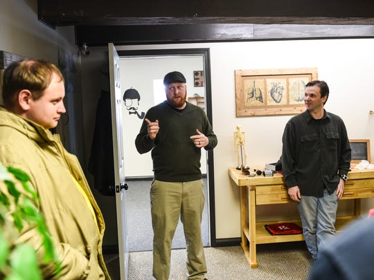 Escape Level 6 owners Mark Sutcliffe (center) and Michael VanScyoc (right) talk about the the Blue Eyed Six room at Escape Level 6 in Annville on Tuesday, January 26, 2016.