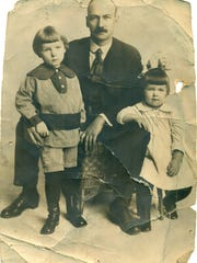 This is the photo Joe Fountain carried with him during World War I. Martha Lange, author of this article, identifies the three as her grandfather, Edward Reeves; her mother, Elizabeth Reeves, 2, on the right; and the little boy is her uncle Thomas Reeves, 3. She said they were the only family Joe knew and he loved them dearly.