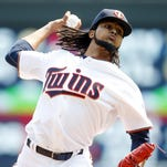Minnesota Twins pitcher Ervin Santana throws against the Houston Astros in the first inning of a baseball game Sunday in Minneapolis.