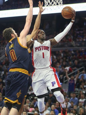 Pistons guard Reggie Jackson scores against Cavaliers forward Kevin love during the second period of Game 3 of the Eastern Conference quarterfinals Friday at the Palace.