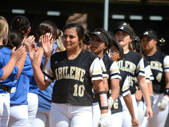Abilene High pitcher Kaylen Washington (10) and her teammates shake hands with Weatherford players after the Lady Eagles' 14-0 win on Tuesday at the AHS softball field.