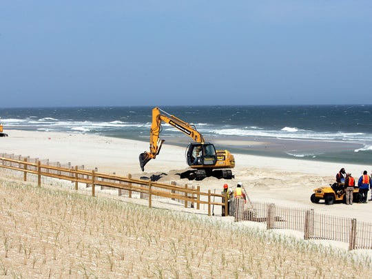 In this 2007 file photo, members of the Army Corps of Engineers dig in the sand on a closed beach near the ocean in Surf City after unexploded ordnance were found. A century after World War I ended, munitions from that and other wars continue to surface on beaches around the United States, usually during beach replenishment projects when they are sucked from the ocean floor and pumped ashore onto the sand, or exposed by strong storms.