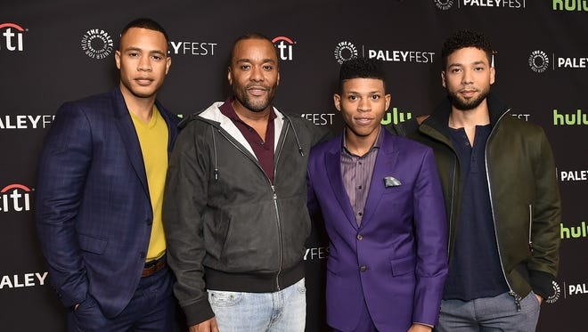 """'Empire' co-creator Lee Daniels, second from left, poses with the actors who play the Lyon sons: Trai Byers, Bryshere """"Yazz"""" Gray and Jussie Smollett at PaleyFest in Los Angeles on Friday."""