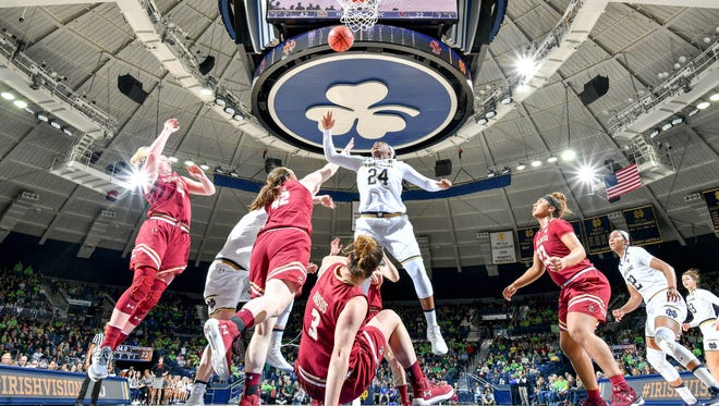 Notre Dame Fighting Irish guard Arike Ogunbowale (24) shoots as Boston College Eagles center Katie Quandt (42) defends in the first half at the Purcell Pavilion.
