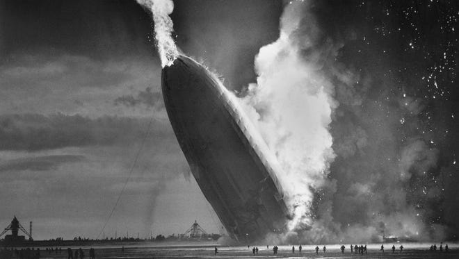 The German dirigible Hindenburg crashes to the ground, tail first, in flaming ruins after exploding on May 6, 1937, at the U.S. Naval Station in Lakehurst, N.J. The hydrogen-filled Hindenburg ignited while easing toward its mooring mast  The blaze killed 35 people on board and one person in the ground crew; 62 passengers and crew members survived.
