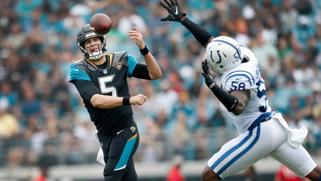Jacksonville Jaguars quarterback Blake Bortles (5) scrambles away from Indianapolis Colts linebacker Tarell Basham (58) in the first half of their game at EverBank Field on Sunday, Dec. 03, 2017.