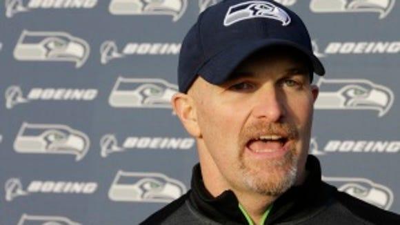 Seattle defensive coordinator Dan Quinn talks to reporters after practice Wednesday. (AP Photo/Ted S. Warren)