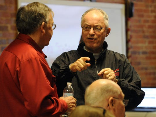 Bruce McAtee, right, talks to Democratic Party Chairman