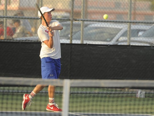 Cooper's Michael Scarborough hits a backhand to Abilene