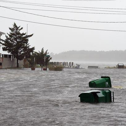 Homes on Read Street in Dewey Beach have rising water