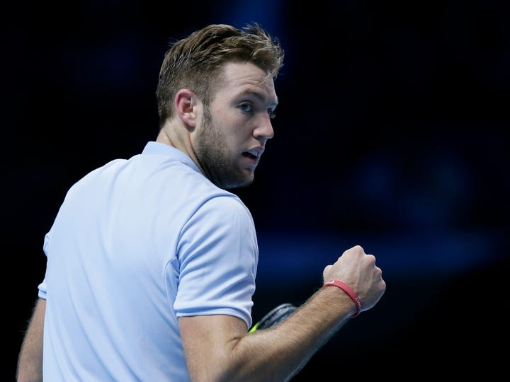 Jack Sock of the United States celebrates winning a point against Grigor Dimitrov of Bulgaria during their ATP World Tour Finals semifinal tennis match at the O2 Arena in London, Saturday Nov. 18, 2017. (AP Photo/Tim Ireland)