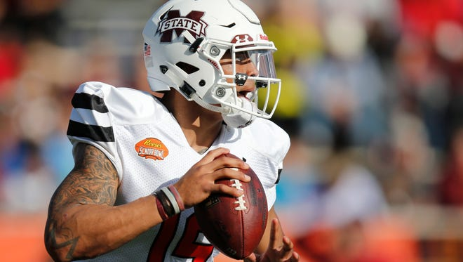 Dak Prescott of Mississippi State looks for a receiver during the first half of the Senior Bowl Saturday.