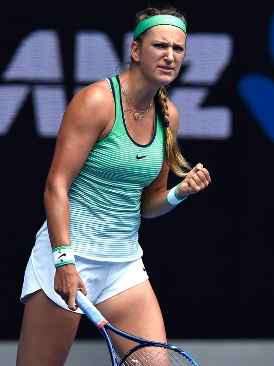 Victoria Azarenka of Belarus celebrates after winning a point against Danka Kovinic of Montenegro during their second round match at the Australian Open tennis championships in Melbourne, Australia, Thursday, Jan. 21, 2016.(AP Photo/Andrew Brownbill)