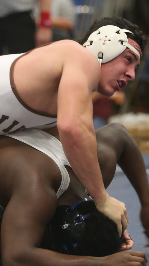 Clarkstown South's Jake Spreckman on his way to defeating Middletown's Horace Duke in the 195-pound weight class during the finals of the Patriot wrestling tournament at John Jay High School in Hopewell Junction Dec. 12, 2015.
