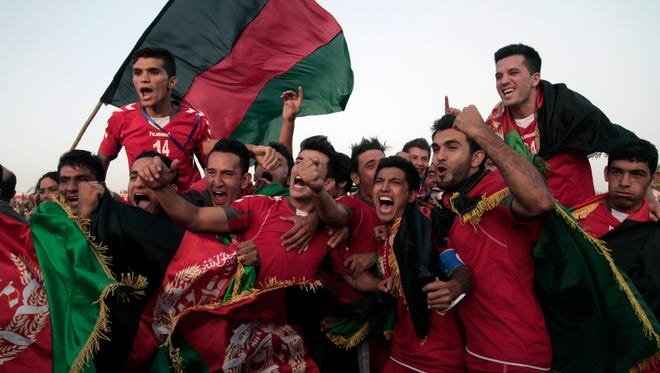 Afghanistan's national football team celebrates its win against India in the South Asian Football Federation Championship on Sept. 11, 2013 in Kabul, Afghanistan.