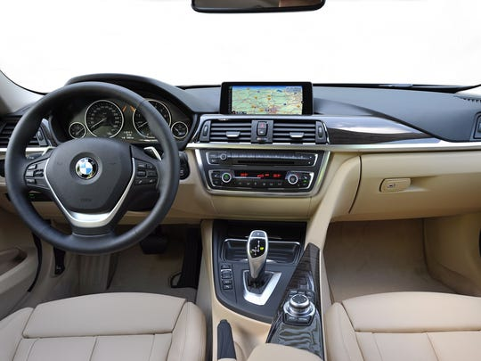 The interior of the 2014 BMW 328d xDrive Sports Wagon balances serious driving with upscale luxury with big analog gauges, rain-sensing wipers and automatic climate control.