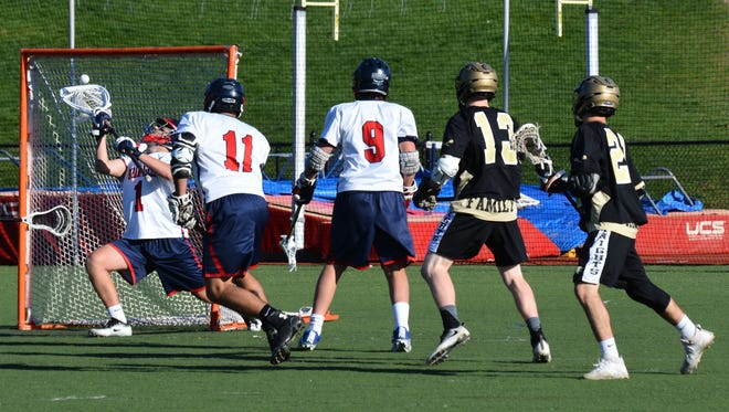 Byram Hills netminder Griffen Rakower stops a shot by Nanuet's Tom Fay (13) on Tuesday during the Bobcats' 7-5 win over the Golden Knights.