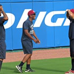 Newly acquired reliever Angel Reyes (middle) joking with fellow bullpen member Kelvin de la Cruz (left) and pitching coach Cory Domel (right).