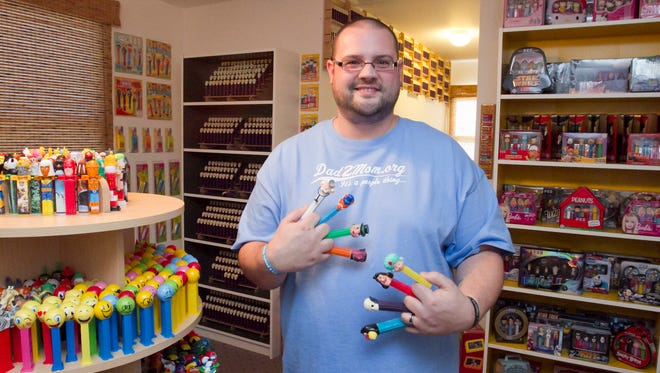 Jim Blaine of Hartland holds several of his more rare or sought-after Pez dispensers amid his collection. Some of them he won't part with, but he trades worldwide.