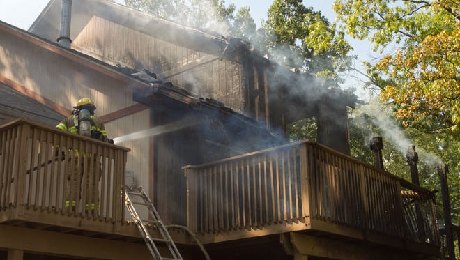 Hamburg, Putnam and Brighton Area fire departments respond to a house fire in the 2500 block of Rush Lake Road in Hamburg Township Wednesday, July 19, 2017. No one was injured in the fire.