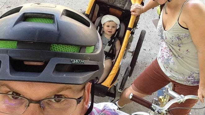 Mike Sule, the founder of Asheville on Bikes, a 501(c)3 organization that will hold its 9th annual Bike Love Saturday, Feb. 13, is seen here with his wife, Emily, and daughter Eila Ray, on their first bike ride as a family.