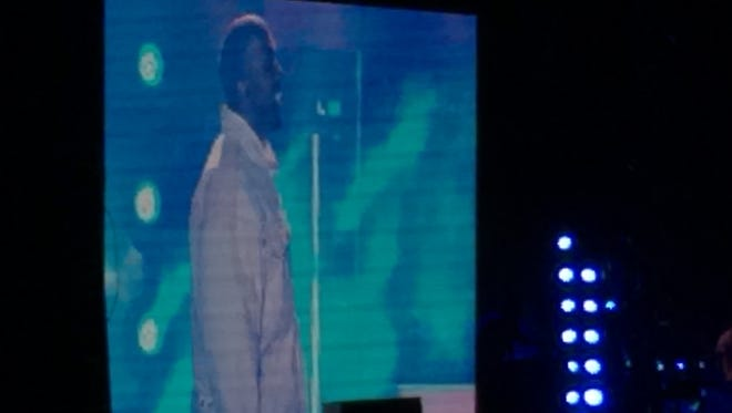 This grainy image of Kanye West as he surprised the crowd and jumped up during A$AP Rocky's set on Friday.
