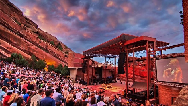 Red Rocks Amphitheater near Denver is surrounded by the natural red sandstone formations that gave it its name.