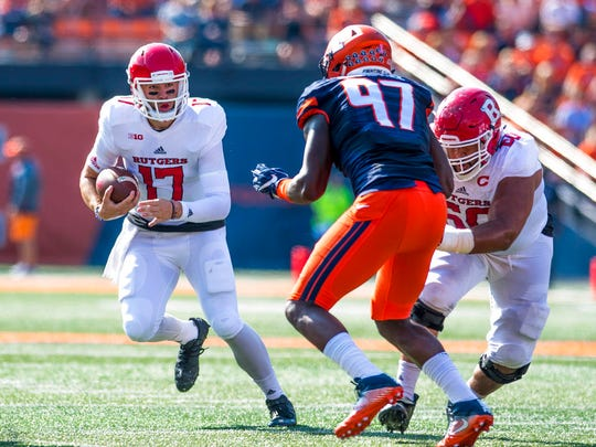 Rutgers quarterback Giovanni Rescigno (17) tries to avoid a tackle by Illinois defensive lineman Bobby Roundtree (97) during the second quarter of an NCAA college football game Saturday, Oct. 14, 2017, at Memorial Stadium in Champaign, Ill. (AP Photo/Bradley Leeb)
