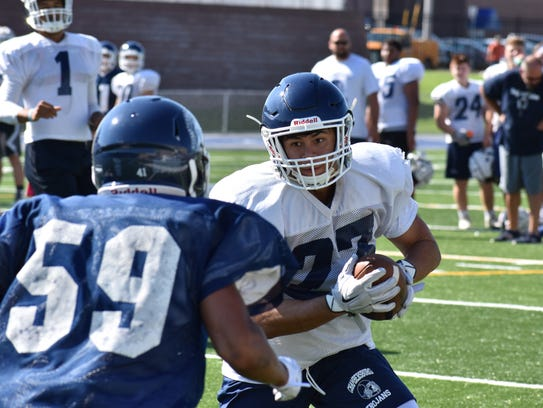 The Chambersburg football team participates in heat