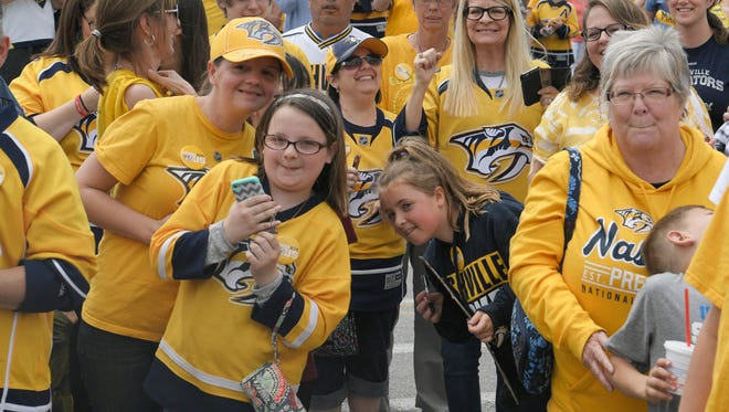 Fans welcome home Nashville Predators players and staff with an airport pep rally in Nashville on Sunday, April 16, 2017.