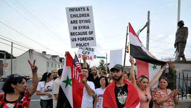 Members of a local Syrian community rallied Tuesday in Allentown, Pa., to protest U.S. military intervention in Syria.