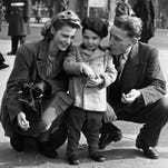 A stylish Charles Robert Watts, 2, with his mother, Lillian, and father, Charles, in Piccadilly Circus in 1943. Charlie was known as Charlie Boy, and his dad was called Charlie.