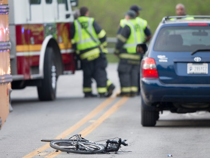 A mangled bicycle sits at the scene of a  fatal crash involving a bicyclist and a  school bus at Westlane and Ditch roads on Thursday, April 24, 2014.