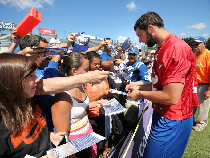 Indianapolis Colts quarterback Andrew Luck signs autographs for fans after the last day of Colts training camp at Anderson University on Wednesday, August 13, 2014.