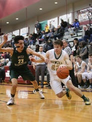 Howell's Dan Zolinski, who had 10 points, drives against