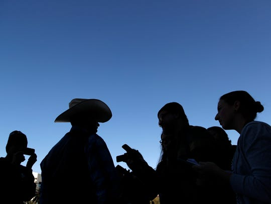 Ryan Bundy (second from left) speaks with reporters