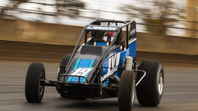 Kyle Larson slides into turn 1 during the USAC Silver Crown Champ Car Series Bettenhausen 100 at the Springfield Mile at the Illinois State Fairgrounds Sunday. Larson won the race.