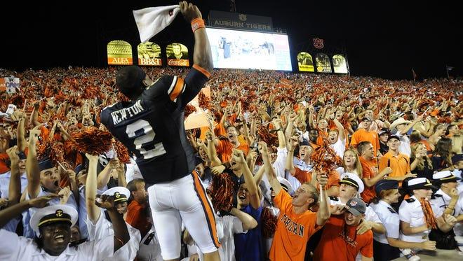 Auburn quarterback Cam Newton celebrates with fans following the Auburn South Carolina game at Jordan-Hare Stadium in Auburn, Ala. on Saturday September 25, 2010.(Montgomery Advertiser, Mickey Welsh)