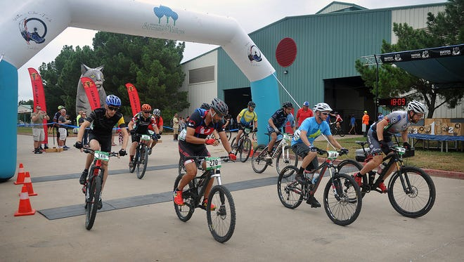 A group of Cat 2 riders leave the starting line at the Bridwell Ag Center for the Hotter 'N Hell Hundred Off-Road Race.