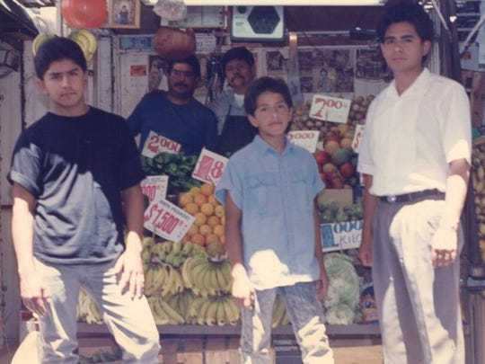 Roberto Gomez Jr., right, and his family pose for a picture in 1981 in Juárez, Mexico. Standing with Roberto in front of the fruit stand are brothers Luis Gomez, left, and Jaime Gomez. Behind the stand are their father Roberto Gomez Sr., right, and uncle Jose Rodriguez.