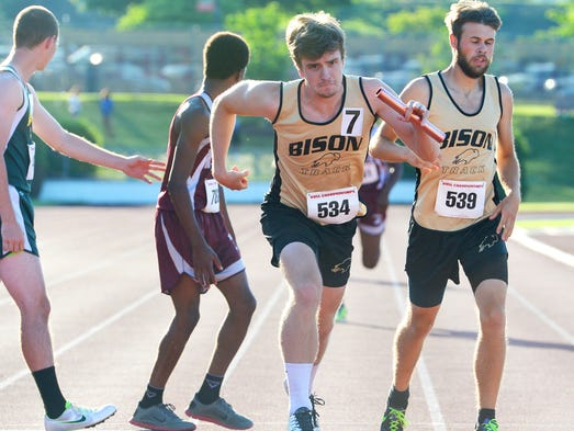 Buffalo Gap's Conor Cahill takes off after receiving the baton from teammate Cole Young in the boys' 4x800 meter relay during the first day of the VHSL Group 2A state track and field championships at Radford University on Friday, June 6, 2014.
