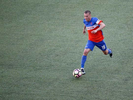 FC Cincinnati midfielder Corben Bone (19) looks to