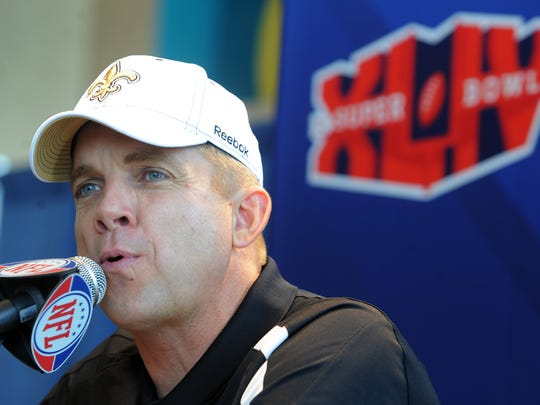 New Orleans Saints head coach Sean Payton talks to members of media during Super Bowl Media Day at Sun Life Stadium in 2010