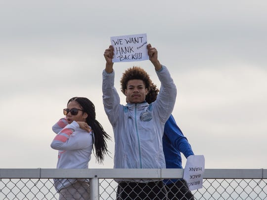 A Washington High School Student holds a sign in protest of the recent termination of Principal Sidney Hankerson on Friday, March 11, 2016.