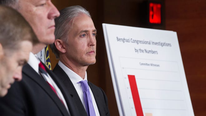 House Benghazi Committee Chairman Rep. Trey Gowdy, R-S.C., right, listens during a news conference on Capitol Hill in Washington on June 28 to discuss the release of his final report on the 2012 attacks on the U.S. consulate in Benghazi, Libya.