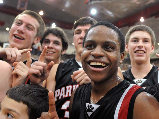 """FILE --- Kevin """"Yogi"""" Ferrell poses with his  Park Tudor team after a semistate win in 2012."""