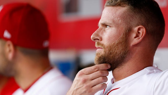 Cincinnati Reds shortstop Zack Cozart (2) looks on from the dugout in the bottom of the second inning of the MLB National League game between the Cincinnati Reds and the St. Louis Cardinals and Great American Ball Park in Cincinnati on Monday, June 5, 2017.