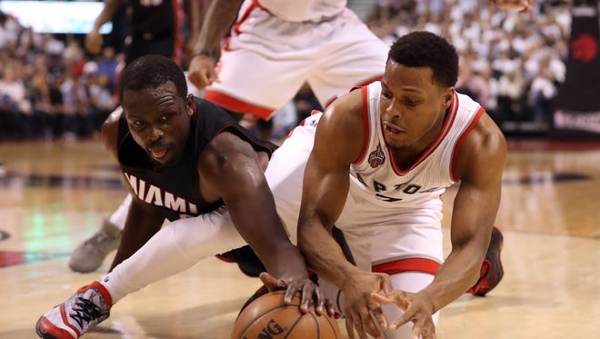 May 11, 2016; Toronto, Ontario, CAN; Toronto Raptors point guard Kyle Lowry (7) battles for a loose ball with Miami Heat forward Luol Deng (9) in game five of the second round of the NBA Playoffs at Air Canada Centre. Mandatory Credit: Tom Szczerbowski-USA TODAY Sports