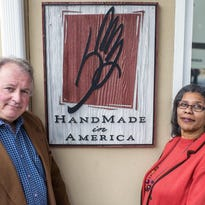 Glenn Cox, HandMade in America executive director, left, and Stephanie Twitty, the nonprofit's Board of Directors chair, stand outside the Asheville office on South Lexington Avenue in December 2014.